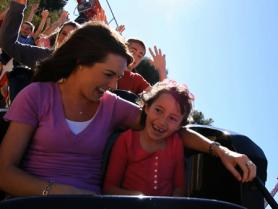 Mother and daughter on a roller coaster