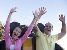 Father and daughter on roller coaster