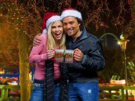 Festive couple with hot cocoa