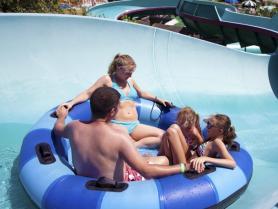 Family riding raft on Big Kahuna