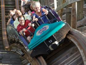 Close up shot of guests riding The Boss roller coaster