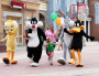 LOONEY TUNES characters walk with small child
