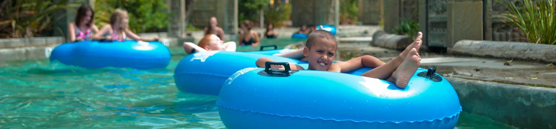 kids on tubes on lazy river