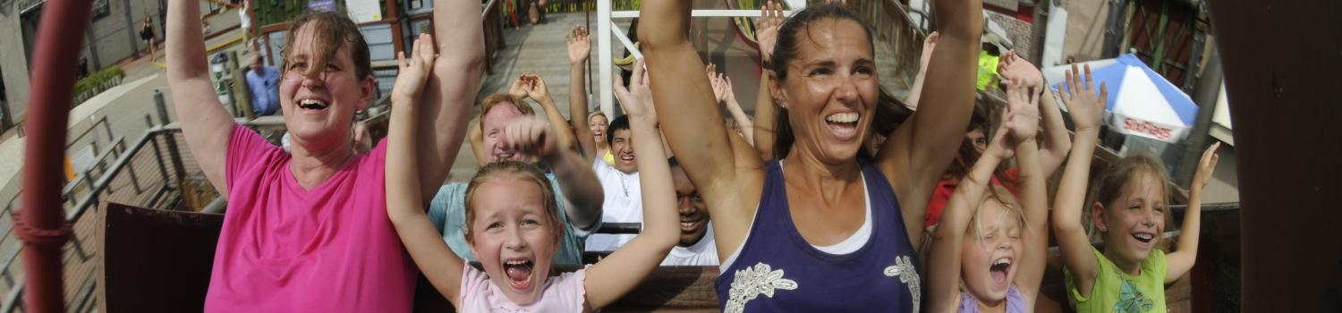 Moms and daughters on a coaster at Six Flags
