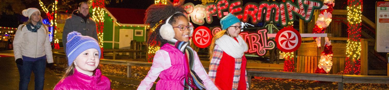 Children skip through Candy Cane Lane