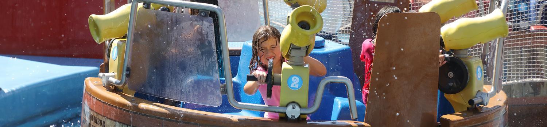 Little girl shooting water
