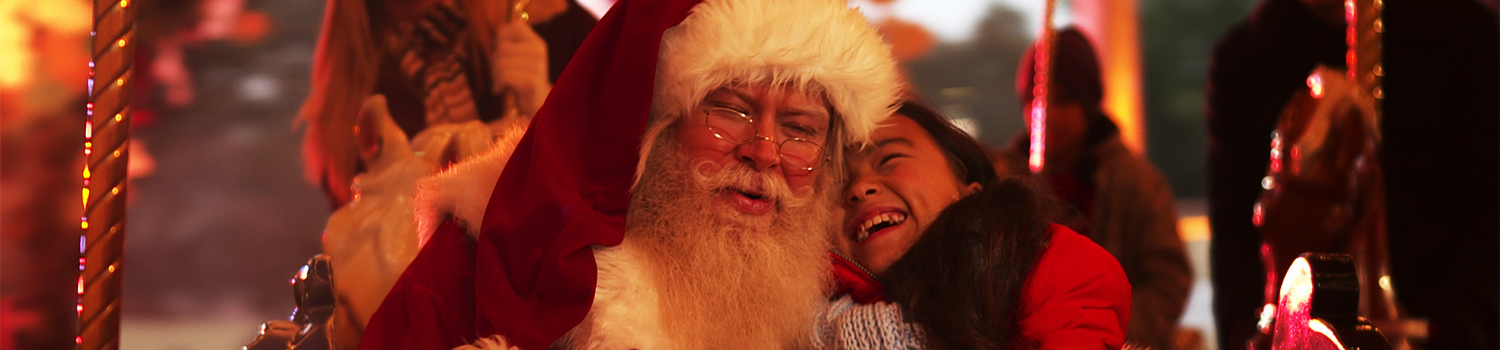 Santa and child on Carousel at Six Flags New England