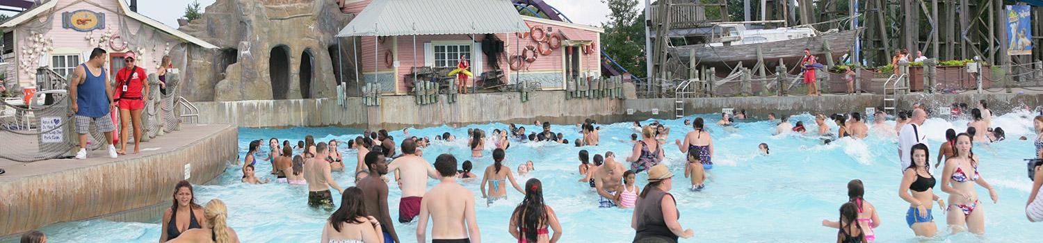 Guests enjoying Commotion Ocean water park pool at Six Flags New England Hurricane Harbor