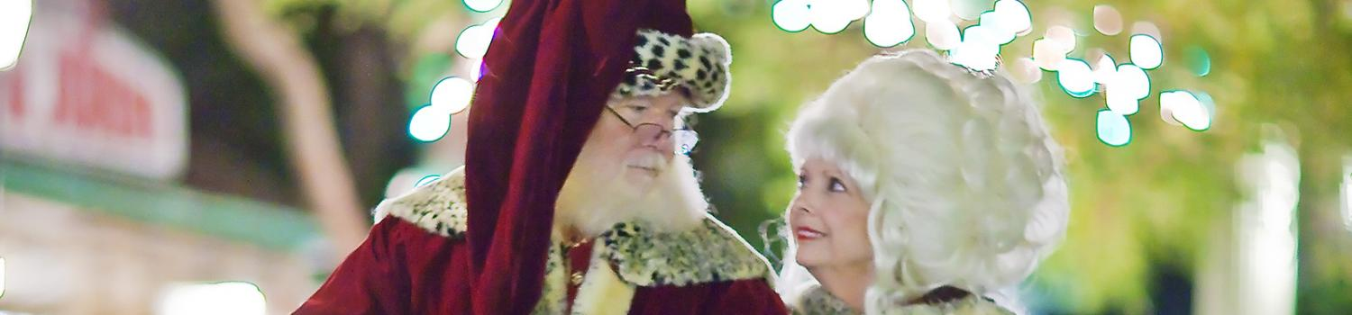 Santa and Mrs. Claus look at one another
