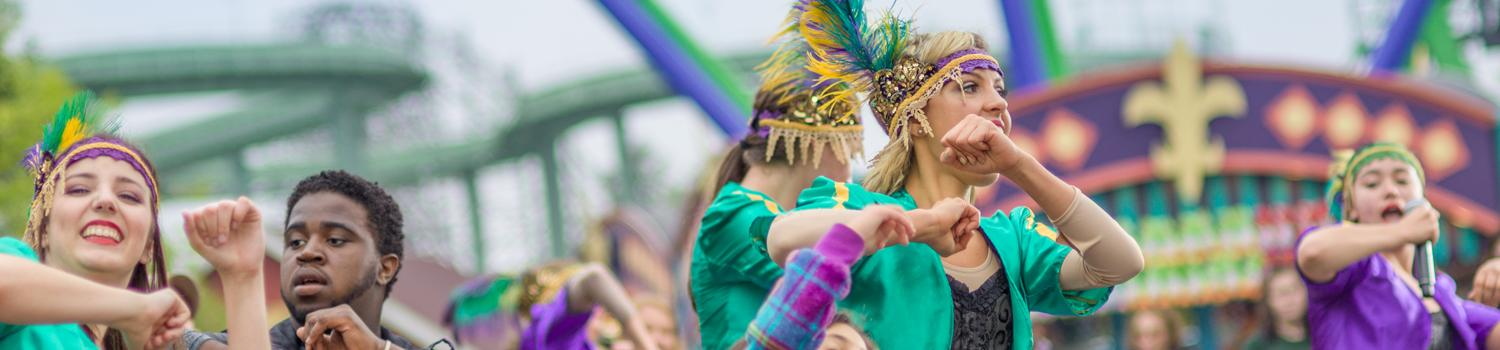party gras performers dancing with guests
