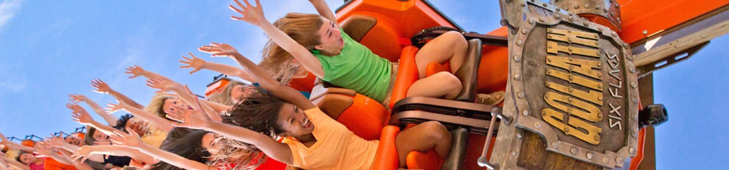 Two guests with Season Passes enjoy a roller coaster at their favorite Six Flags theme park.