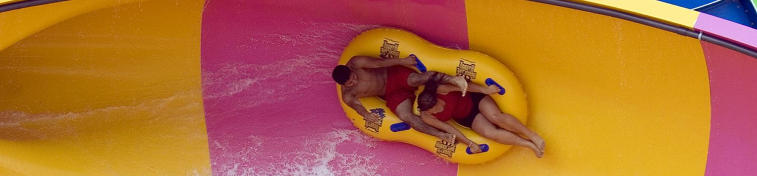 guests going down slide in Hurricane Harbor