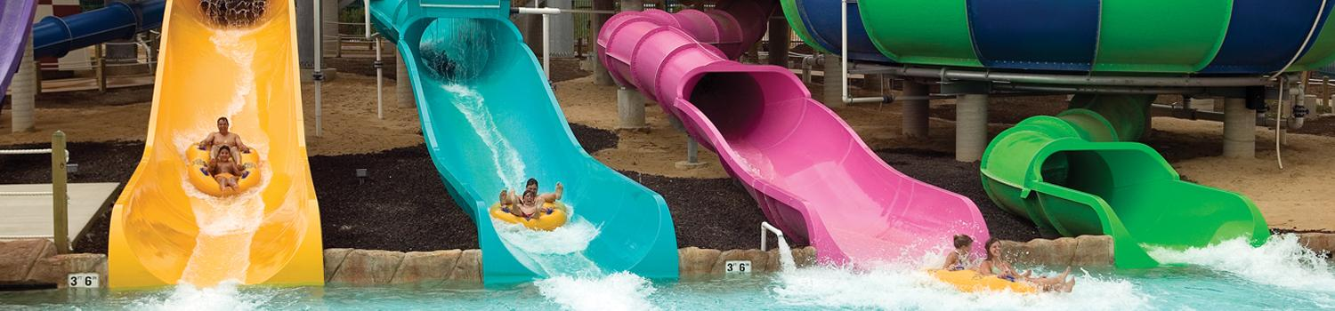 Guests riding water slide
