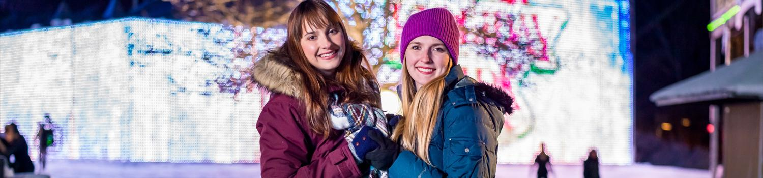 girls drinking hot chocolate at Holiday in the Park
