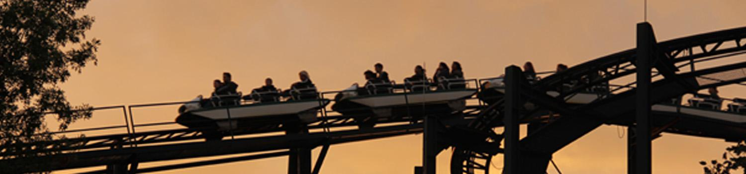 Top of Whizzers lift hill during an orange dusky sunset