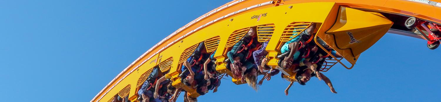 guests riding Mardi Gras Hangover upside down