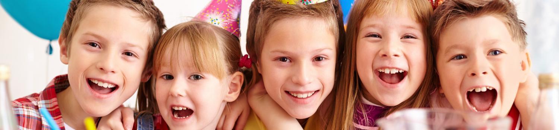 children in birthday hats