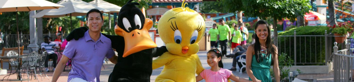 People dancing with Looney Tunes characters