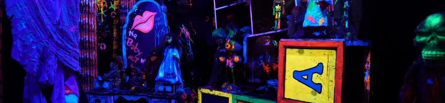 Creepy, glow in the dark room in Midnight Mansion during Fright Fest at Six Flags New England