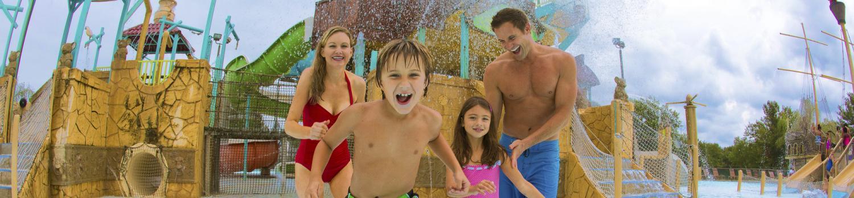 Family splashing through water at Hurricane Harbor