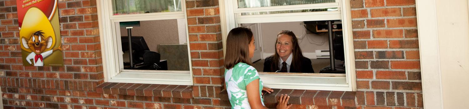 Girl speaking with Guest Relations workers