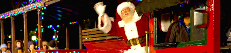 Santa Claus taking a trip upon The Six Flags RailRoad