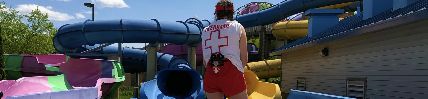 Lifeguard awaiting sliders at the bottom of The Abyss
