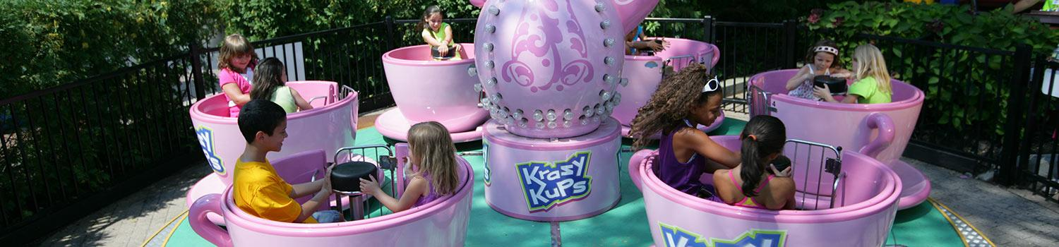 Children riding Krazy Kupz at Six Flags New England