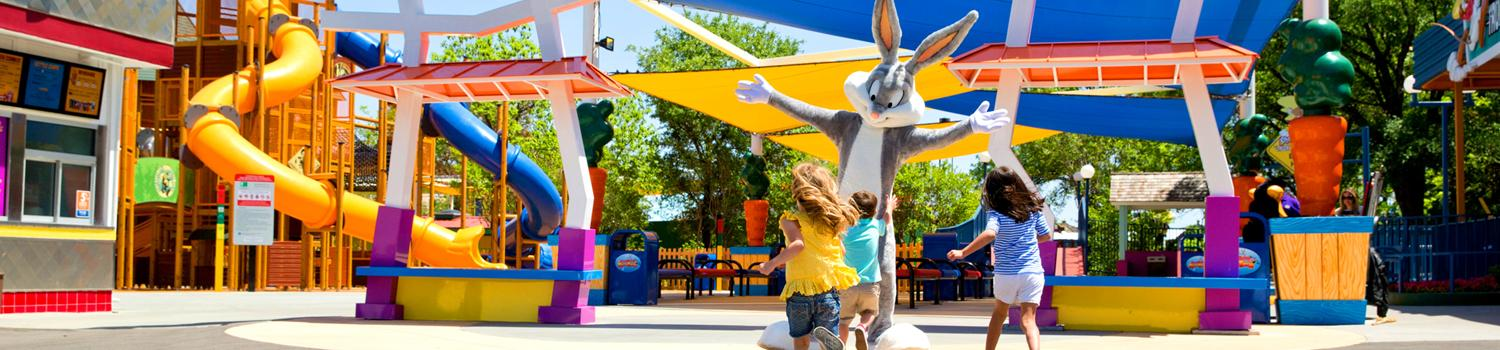 Bugs Bunny greets children as they enter Bugs Bunny Boomtown