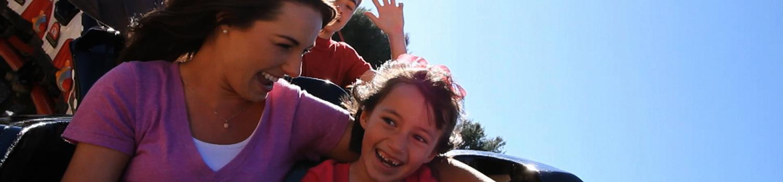 Family on a kids coaster
