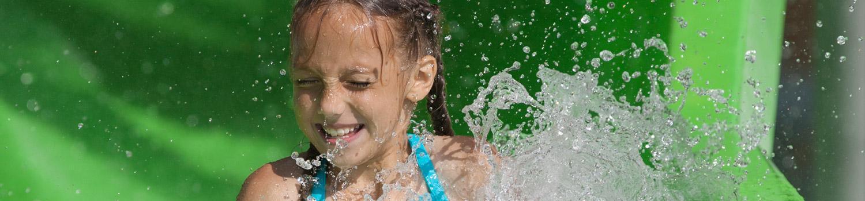 Close up of littler girl splashing in water
