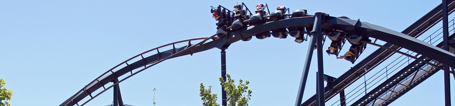 Wide shot of the Batman the Ride train traveling the cork screw