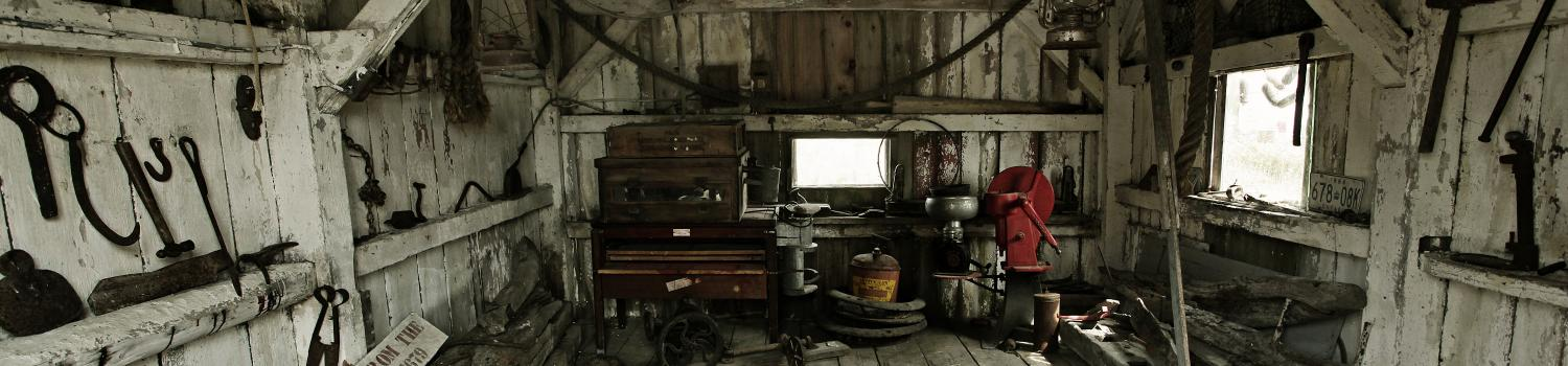 Inside of creepy wooden shack with blood and cobwebs