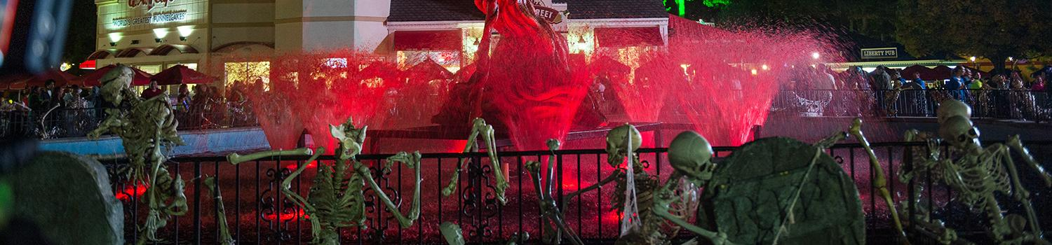 Blood red fountain with skeletons surrounding it during Fright Fest