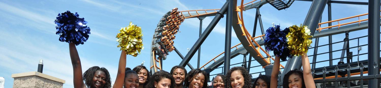 cheerleaders in front of coaster
