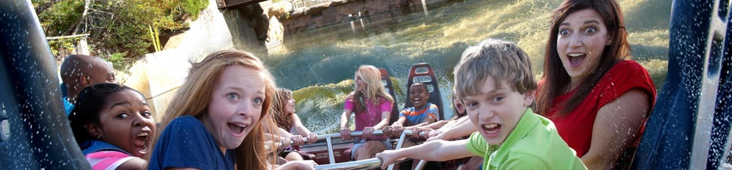 Guests on family raft water ride
