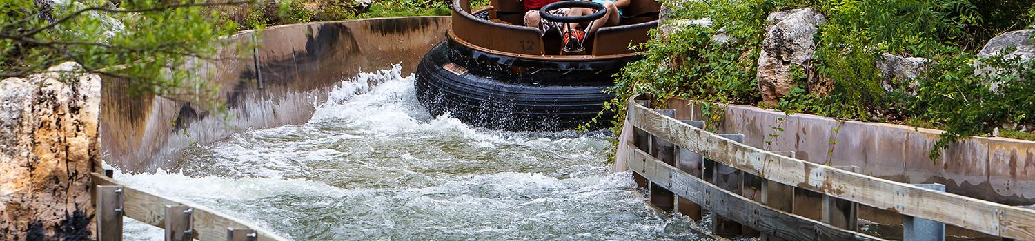 Guests in Gully Washer raft riding the rapids
