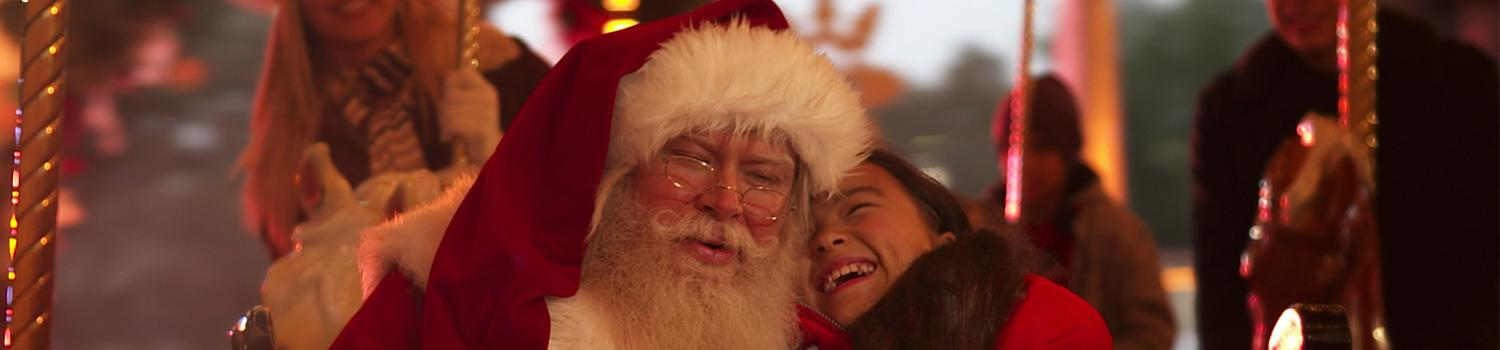 Santa being cheerful with a guest