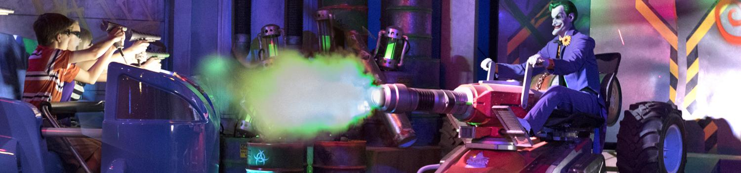 The Joker shoots a fireball at a car of guests on the Justice League Battle for Metropolis ride