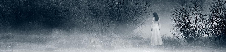 Lady walking along the lakefront in fog