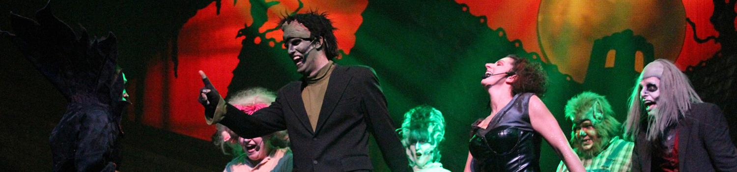 Dancing zombies on stage performing in Love at First Fright at Six Flags