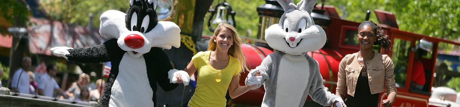 Looney Tunes characters walking with guests