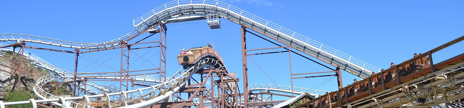 Roadrunner Express coaster vehicle with guests on top of lift hill