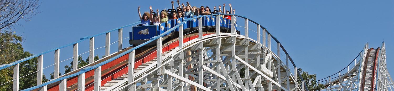 A train travels the Screamin Eagle ride course