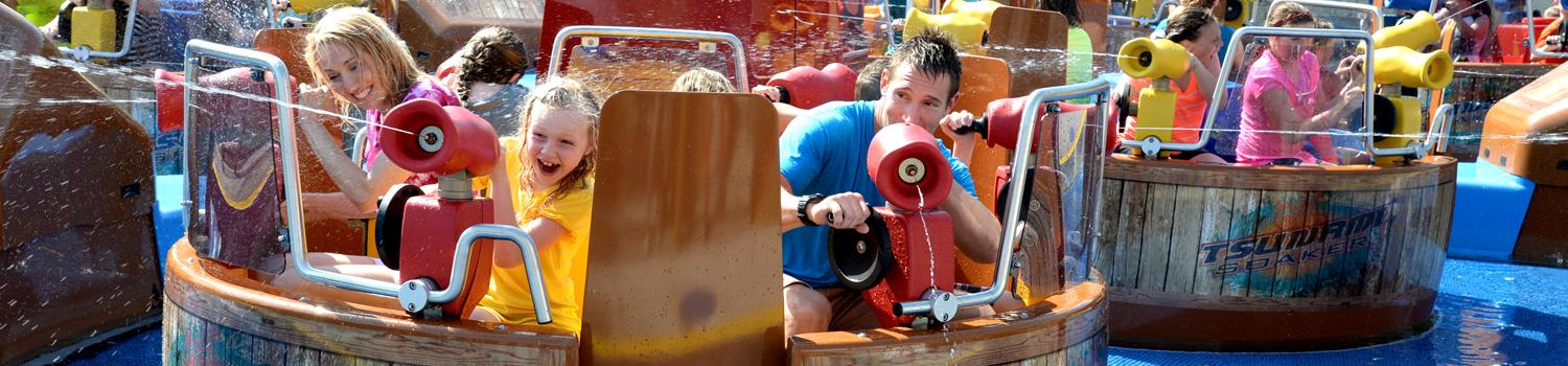 Close up photo of Tsunami Soaker guests spraying water at other guests
