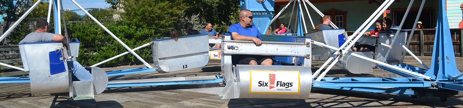 Guests looking back on spinning arm of Wave Runner