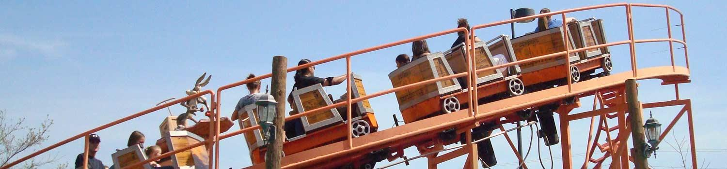 Guests slowly climb up the hill of Wile E. Coyote's Grand Canyon Blaster