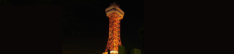 Oil derrick lit up at night