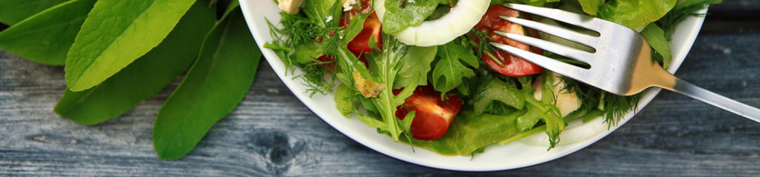 A delicious green salad in a big white bowl