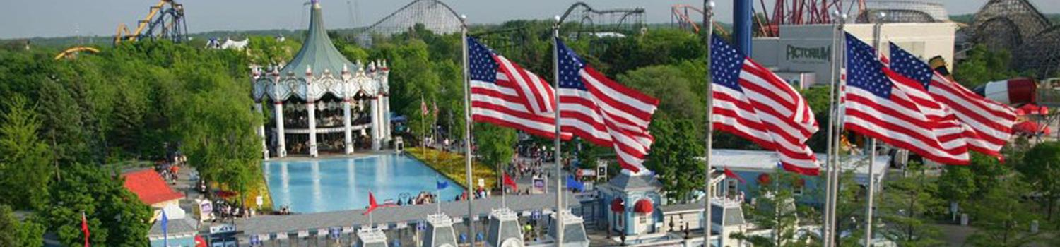 Salute to Service weekend with Six Flags Great America entrance and flags